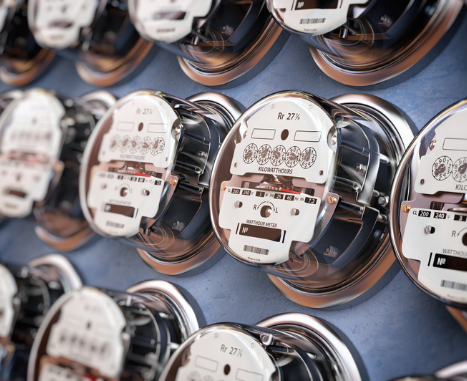 Electric meters in a row measuring power use.