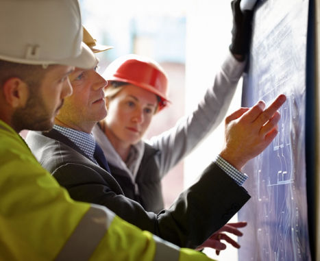 Architect, building owner, and building engineer discuss site plans