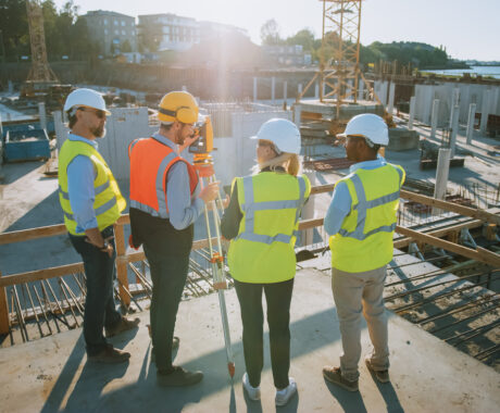 Group of building engineers talking at construction site